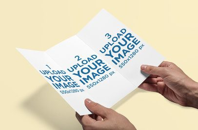 Mockup of a Man Holding a Trifold Brochure 4182-el1