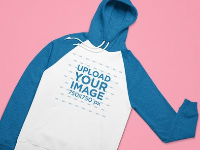Mockup of a Raglan Style Pullover Hoodie on a Flat Surface 25646