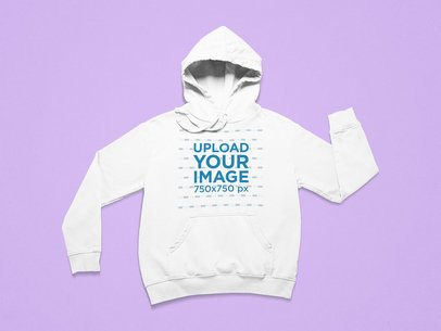 Mockup of a Pullover Hoodie with Folded Sleeves on a Colorful Surface 25721