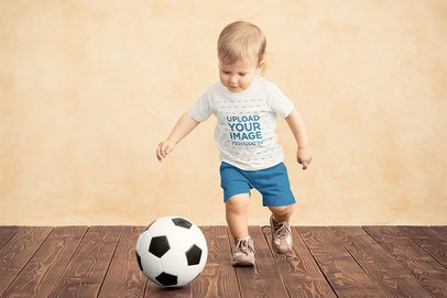Mockup of a Boy with a T-Shirt Playing with a Soccer Ball 34405-r-el2