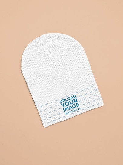 Mockup of a Beanie Lying Flat on a Colored Surface 25643
