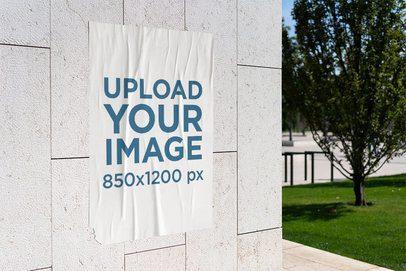 Mockup of a Poster Glued Onto a Wall 4147-el1