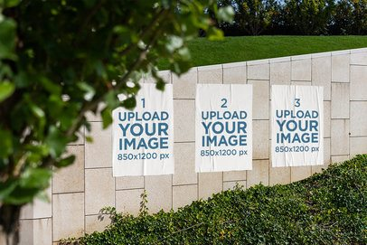 Mockup of Three Paper Posters on a Wall 4149-el1