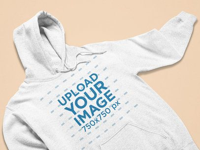 Closeup-View Mockup of a Heathered Hoodie on a Flat Surface 25346