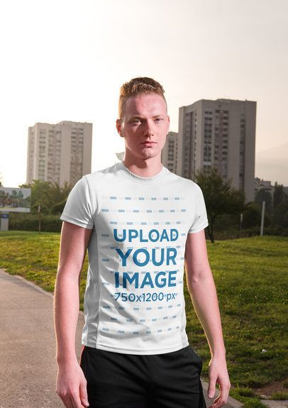 Mockup of a Serious-Looking Man Wearing a Round Neck Tee Against City Buildings 34409-r-el2
