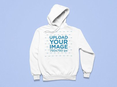 Flat Lay Mockup of a Pullover Hoodie over a Customizable Surface 25492