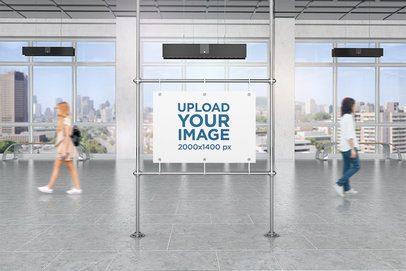 Mockup of a Horizontal Poster in a Public Corridor 4104-el1