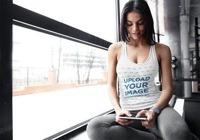 Tank Top Mockup of a Woman at the Gym Texting on Her Phone 34338-r-el2