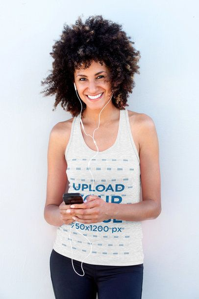 Mockup of a Happy Woman with Curly Hair Wearing a Heathered Tank Top 33829-r-el2