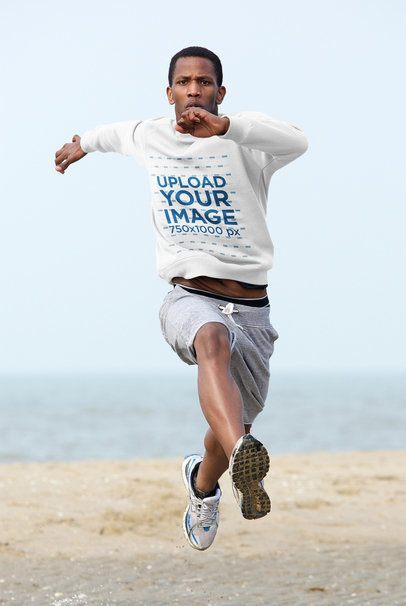 Mockup of a Man with a Sweatshirt doing a Long Jump  34203-r-el2