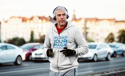 Mockup of a Senior Man with a Heathered Full-Zip Hoodie Jogging on the Street 34287-r-el2