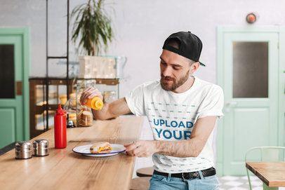 T-Shirt Mockup Featuring a Man Eating a Hamburger 34480-r-el2