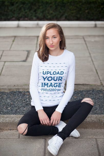 Long Sleeve Tee Mockup of a Young Woman Sitting on a Sidewalk 4332-el1