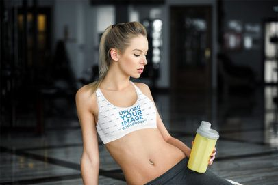 Sublimated Sports Bra Mockup Featuring a Woman Posing at a Gym 34457-r-el2