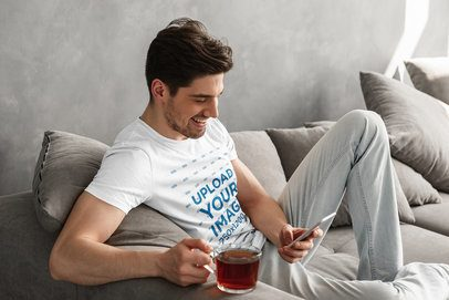Round Neck Tee Mockup Featuring a Man Checking His Phone at Home 34706-r-el2