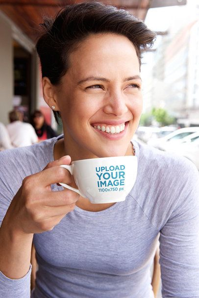 Mockup of a Smiling Woman with Short Hair Holding an Espresso Cup 34796-r-el2