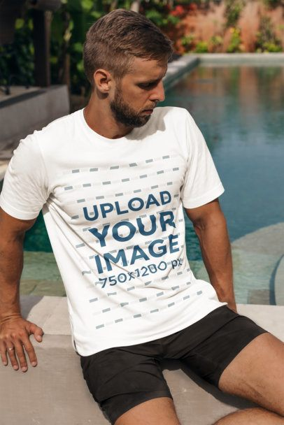Mockup of a Bearded Man with a T-Shirt Sitting by a Pool 4349-el1