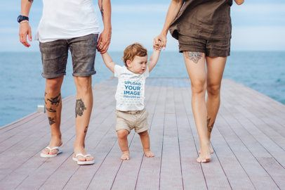 T-Shirt Mockup of a Baby Boy Taking His First Steps with Mom and Dad 34302-r-el2