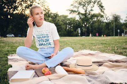 T-Shirt Mockup of a Woman Listening Music on a Park 34473-r-el2