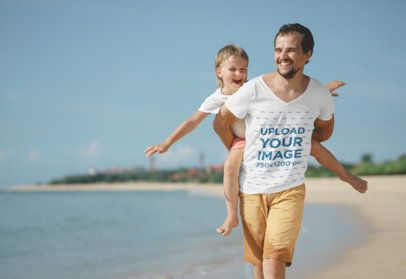 V-Neck Tee Mockup of a Dad Running by the Beach with His Kid on His Back 34372-r-el2