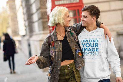 Hoodie Mockup of a Man Hugging His Girlfriend at an European Street 34168-r-el2
