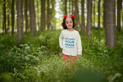Mockup of a Little Girl Wearing a Heathered Sweatshirt in the Woods 34692-r-el2