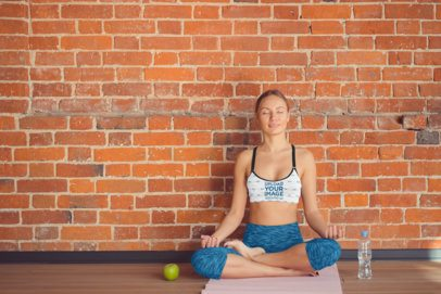 Mockup of a Woman Wearing a Heathered Sports Bra While Meditating 34370-r-el2