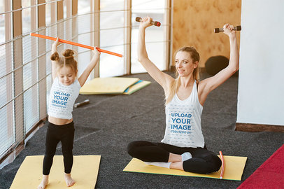 Tank Top Mockup Featuring a Mom Exercising at Home with Her Daughter 34315-r-el2