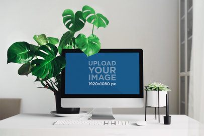 Mockup of an iMac Placed on a Minimalistic Table by a Houseplant 36572-r-el2