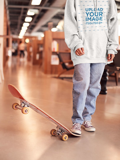 Heather Hoodie Mockup Featuring a Female Skater in an Office 34344-r-el2