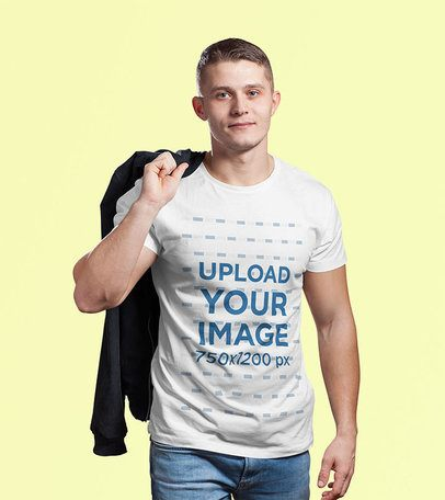 Tee Mockup of a Man Holding Another Garment Over His Shoulder 2978-el1