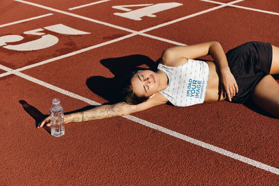 Sports Bra Mockup of a Woman Resting on a Running Track 34733-r-el2