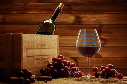 Mockup of a Wine Glass by a Vintage Box in a Warm Setting 36822-r-el2