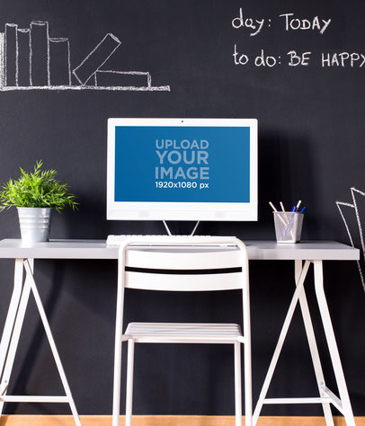 Mockup of a Desktop Computer Placed on a Desk Against a Chalkboard Wall 36566-r-el2