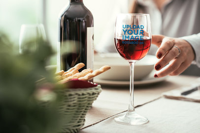 Mockup of a Wine Glass on a Dinner Table 36731-r-el2