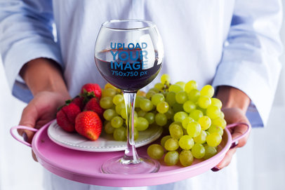 Mockup of a Sommelier Carrying a Tray with a Wine Glass and Berries 36847-r-el2