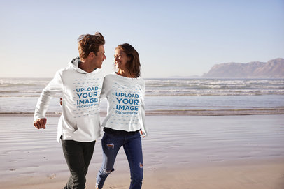 Mockup of a Man with a Hoodie and a Woman with a Sweatshirt Walking by the Beach 34349-r-el2