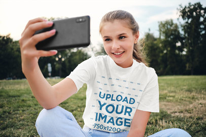 Tee Mockup of a Teenager Taking a Selfie at the Park 34491-r-el2