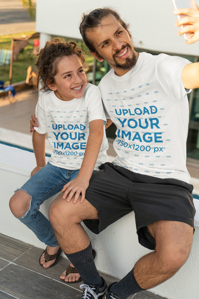 T-Shirt Mockup of a Man Taking a Selfie with His Kid 36766