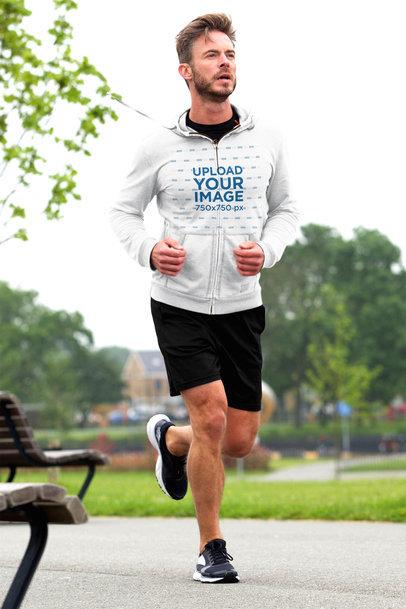 Mockup of a Fit Man Wearing a Full-Zip Hoodie While Jogging 34083-r-el2