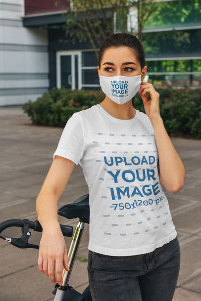 Face Mask Mockup of a Young Woman Wearing a T-Shirt and Standing by a Bicycle 4556-el1