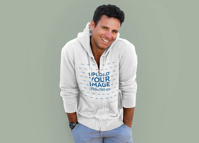 Mockup of a Man with a Heathered Full-Zip Hoodie at a Studio 34084-r-el2