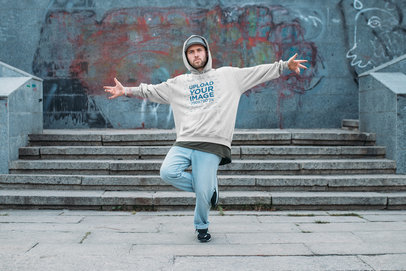 Mockup of a Man with an Oversized Hoodie Posing at an Urban Setting 36973-r-el2