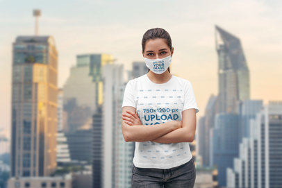 Face Mask Mockup of a Woman Wearing a T-Shirt and Posing With Her Arms Crossed 4562-el1