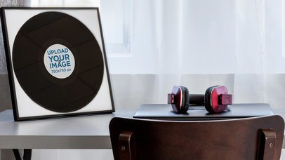 Mockup Featuring a Framed Vinyl Record Placed on a Desk 36950-r-el2