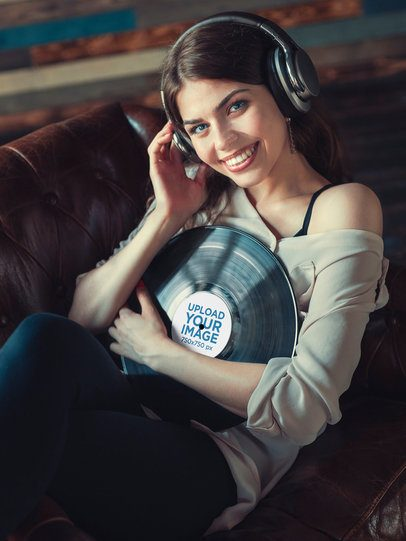 Mockup of a Smiling Woman Holding a Vinyl Record 36906-r-el2