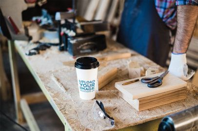 Coffee Cup Mockup of a Man in a Woodworking Workshop 36519-r-el2