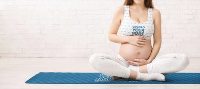Sublimate Sports Bra Mockup of a Pregnant Woman Sitting on a Yoga Mat 37062-r-el2