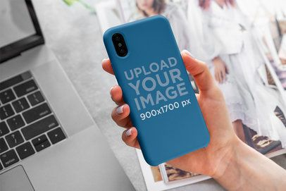 Mockup of a Woman Holding a Phone Case for iPhone 4615-el1