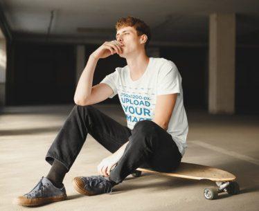 T-Shirt Mockup Featuring a Man Sitting on a Skateboard 37680-r-el2